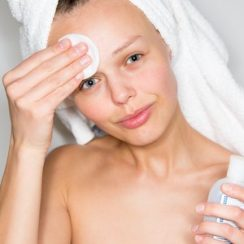 BON-young-woman-removing-makeup-from-her-face